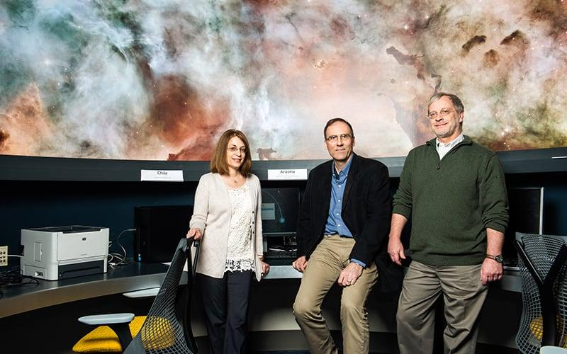 3 physics professors in astronomy lab
