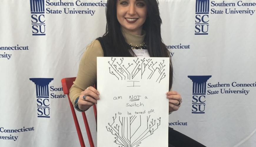 Image of a woman showing a drawing of switch tree, with the words she is not a switch