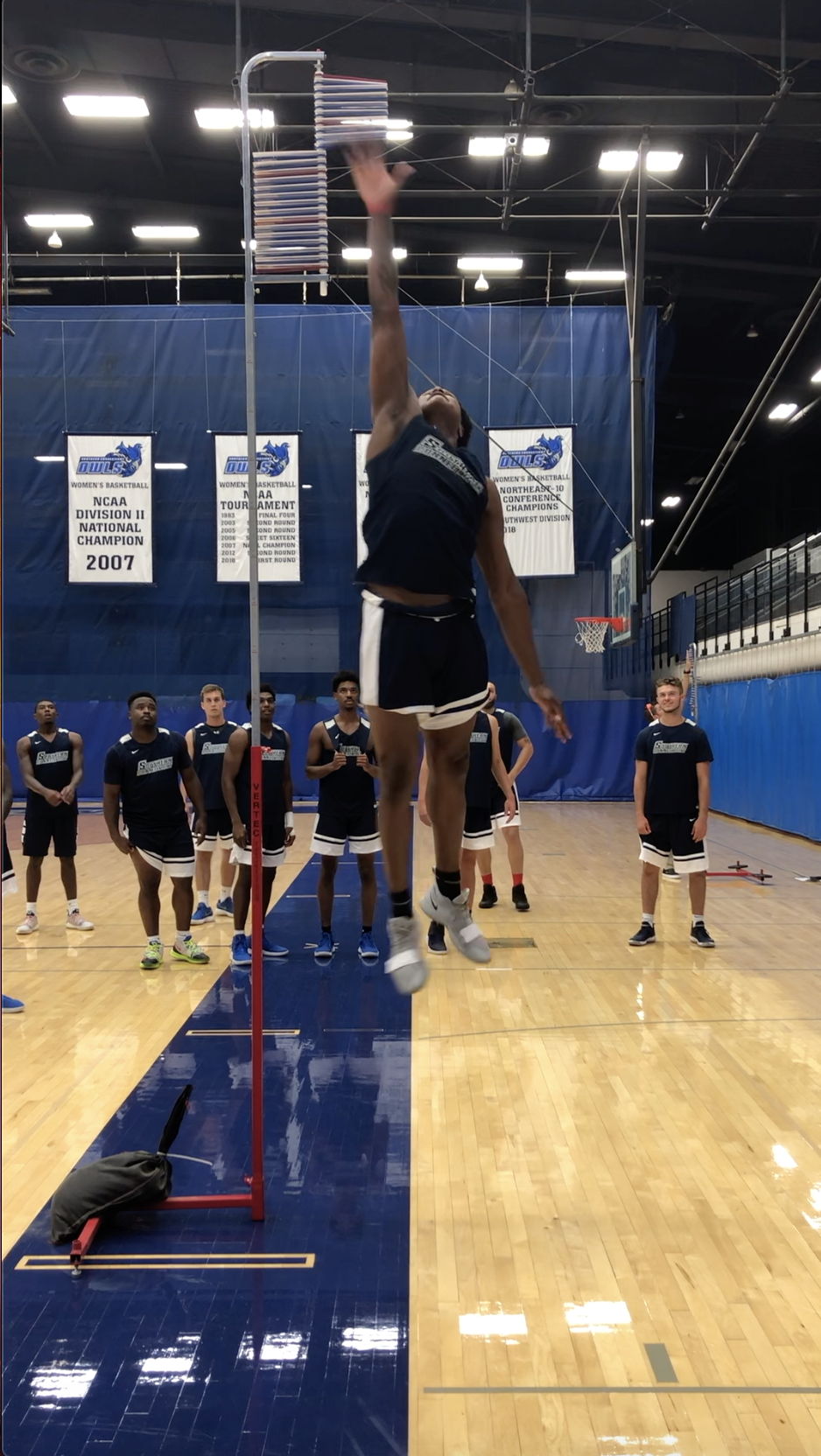 An athlete performing a vertical jump test